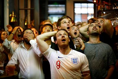 England fans react as they watch Wednesday night\'s World Cup game against Croatia at a bar in central London.
