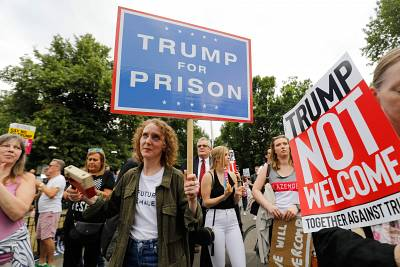 Anti-Trump protesters gather near an entrance to the U.S. ambassador to Britain\'s Winfield House residence on Thursday.