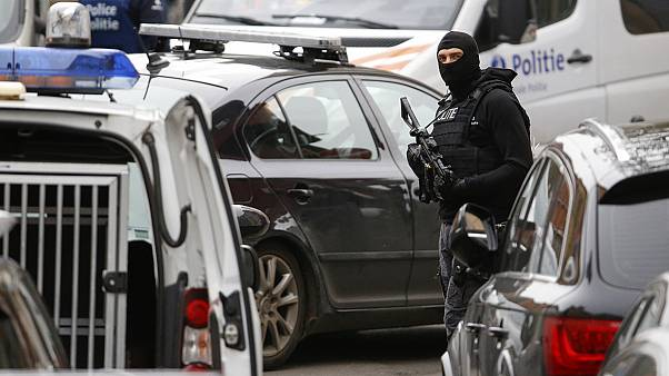 Belgian police make two more arrests as part of Paris attack manhunt