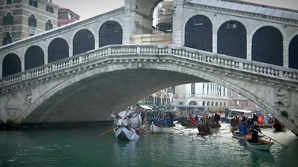 Venice awash with masks and costumes as carnival gets underway