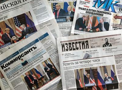 The front pages of Russia\'s main newspapers featuring pictures of the summit.
