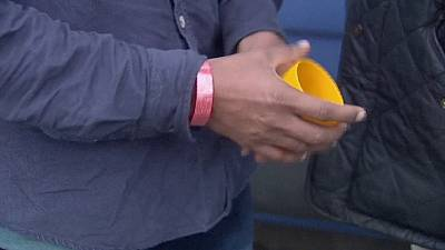 Red wristband plan for migrants dropped in UK