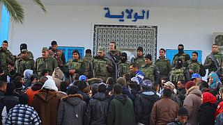 Tunisia's unemployed queue for job application documents