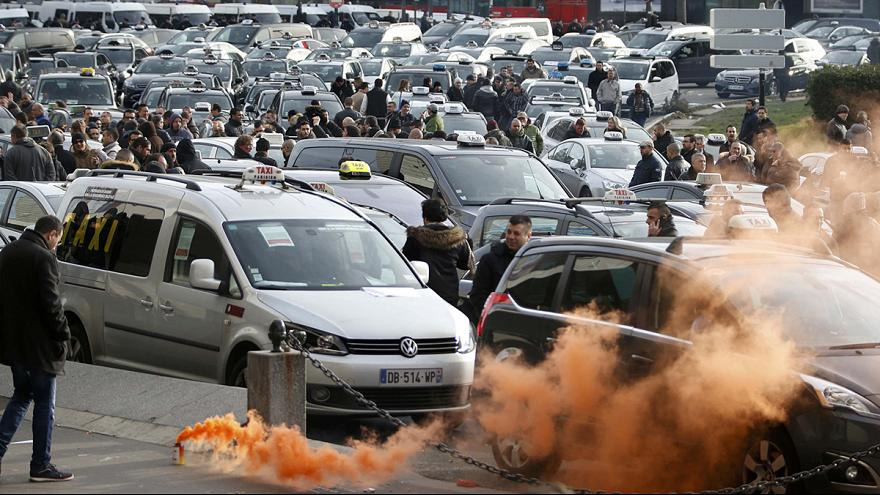 Clashes and arrests in Paris as taxi drivers strike over Uber
