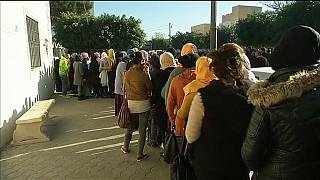 Tunisian unemployed queue for job documents