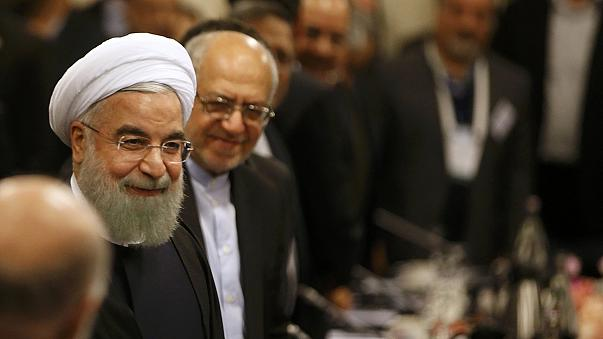 Iran's President Rouhani seeks to revive business ties in Paris