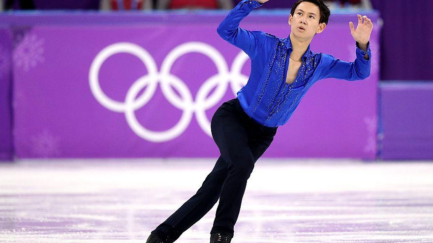 Image:Denis Ten of Kazakhstan performs in the men's single skating short pr