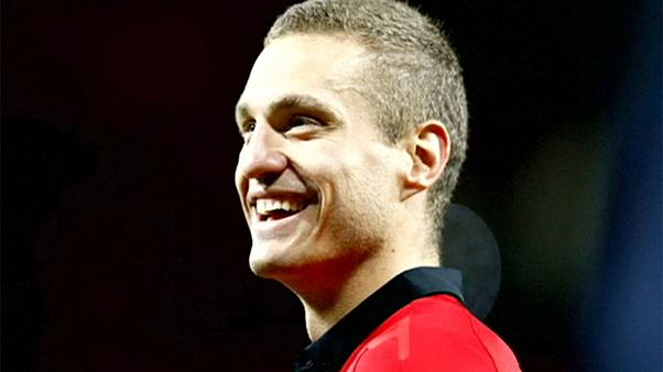 Vidic pendura as chuteiras