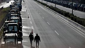 Greek farmers block Athens airport road junction with tractors
