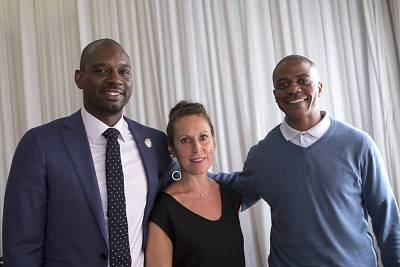 Professor Baz Dreisenger with her first graduate Devon Simmons, left, and South African recent graduate and ex-offender Morgan Makaluza, right.