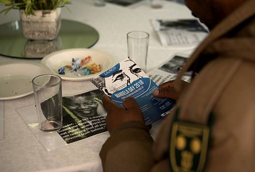 Correctional Services staff listen to speeches during the launch of the Pri