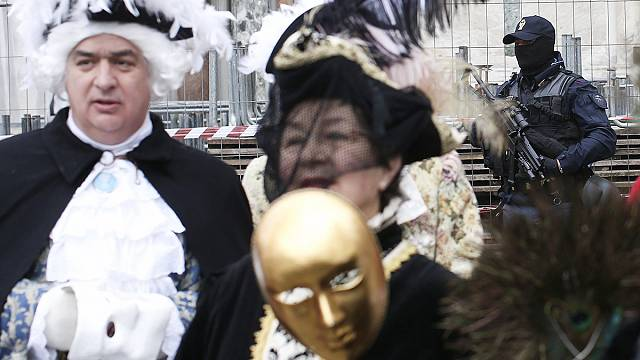 Venice carnival goers asked to lift masks for security