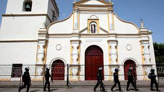 Image: Members of Nicaragua's Special Forces walk past a church during clas
