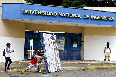 A demonstrator fires a home-made mortar at the police from outside the National Engineering University, during a protest against Nicaragua\'s President Daniel Ortega in Managua, Nicaragua on May 28, 2018.