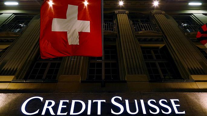 Credit Suisse write-offs hit profit, drag down shares