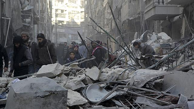 Civilians flee Aleppo as Syrian army and Russian air power lay siege