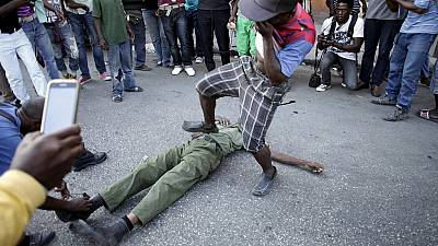 Haiti political crisis worsens, man stoned to death