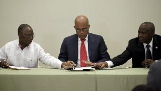 Haitian president agrees to care-taker government