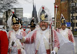 Cologne carnival parade goes ahead despite bad weather