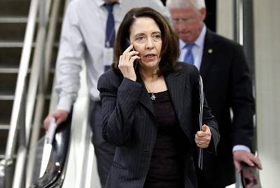 Sen. Maria Cantwell, D-Wash., talks on her phone as she departs after a vote on Gina Haspel to be CIA director, on Capitol Hill on May 17, 2018.