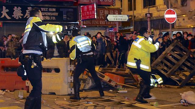 Violent clashes in Hong Kong as police crackdown on street vendors
