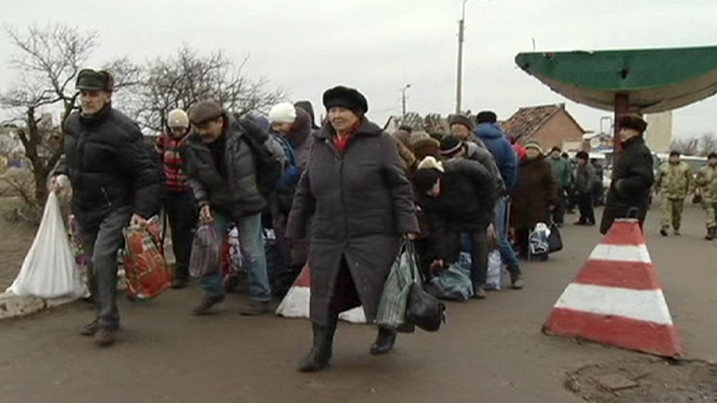 Eastern Ukraine struggles to survive across rebel dividing line