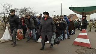 Eastern Ukraine struggles to survive across rebel dividing line