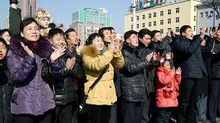 North Koreans celebrate rocket launch