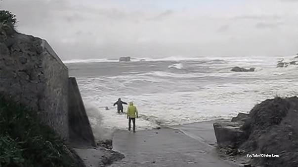 Watch: Elderly couple's close call after being dragged out to sea