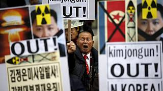 South Koreans protest over neighbour's rocket launch