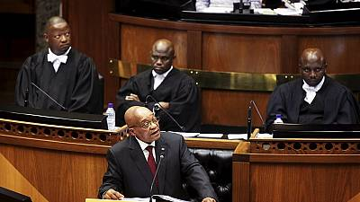 Zuma acknowledges gravity of South Africa's economy amid jeers from opposition MPs