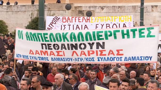 Greek farmers camp outside parliament to protest tax reforms