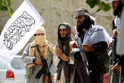 Members of the Taliban celebrate a cease-fire in Afghanistan\'s Nangarhar province on June 16.