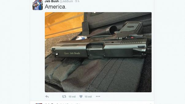 """Presidenciais dos EUA: Jeb Bush lança controvérsia com foto de arma e a palavra """"America"""""""
