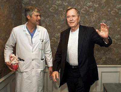 Former President George H.W. Bush leaves Methodist Hospital with his cardiologist, Mark Hausknecht, after a news conference in Houston in 2000.