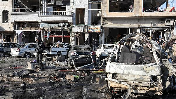 Twin explosions in Homs, Syria kill 46, says monitor