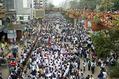 Bangladeshi students shout slogans and block a road during a protest in Dhaka, Bangladesh on Aug. 4, 2018. Five days of protests by tens of thousands of students angry over the traffic deaths of two of their colleagues have largely cut off the capital Dhaka from the rest of Bangladesh, as the demonstrators pressed their demand for safer roads.