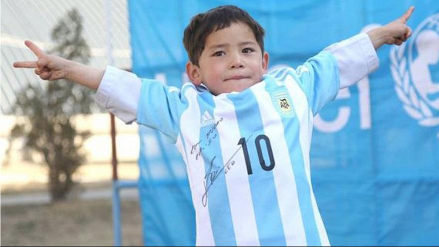 Afghan 'plastic bag Messi' gets to join his idol on the pitch