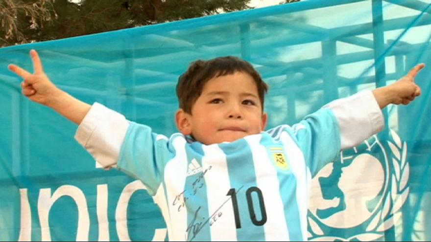 {Watch} From plastic bag to the real thing: Messi delights Afghan boy with signed jersey