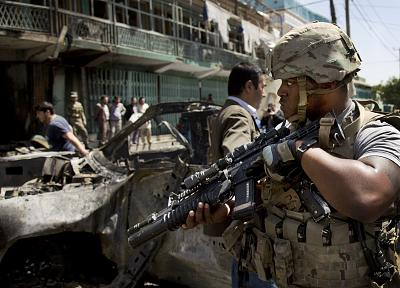 A U.S. soldier arrives at the scene of a suicide car bombing in Kabul in May 2013.