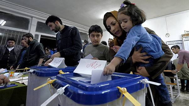 Iran counts votes but a clear winner may take days to emerge