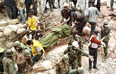 Rescue workers remove the body of a woman from the rubble of the U.S. Embassy building bombing in Nairobi, on Aug 10, 1998.