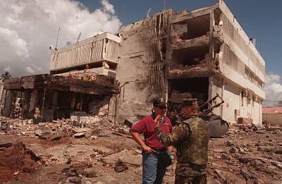 A United States Marine talks with an FBI investigator in front of the damaged U.S. Embassy in the capital Dar es Salaam, Tanzania, on Aug. 15, 1998.