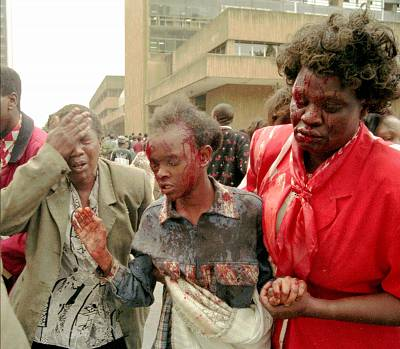 The injured are helped to an ambulance after an explosion ripped apart a building and heavily damaged the United States Embassy in downtown Nairobi, Kenya, on Aug. 7, 1998.