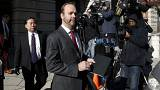 Rick Gates departs after a bond hearing at U.S. District Court in Washingto