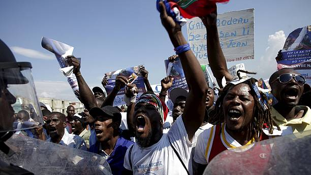 Crisis-hit Haiti marks 2004 coup ahead of runoff elections