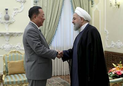 Iranian President Hassan Rouhani, right, greets North Korean Foreign Minister Ri Yong Ho in Tehran on Wednesday.