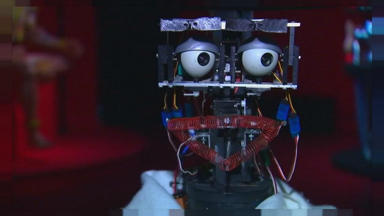 Putting the art into artificial intelligence as a critic robot tours Quai Branly in Paris