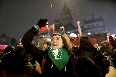 Pro-abortion activists gather in the rain outside the Congress in Buenos Aires, Argentina.