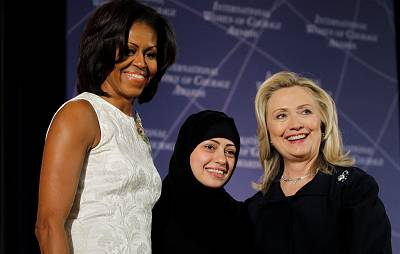 Then-Secretary of State Hillary Clinton and first lady Michelle Obama congratulate Samar Badawi of Saudi Arabia at the State Department\'s 2012 International Women of Courage Award winners. The rights activist was detained by Saudi authorities last week.